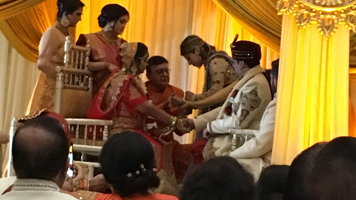 Literally tying the knot in Indian Wedding