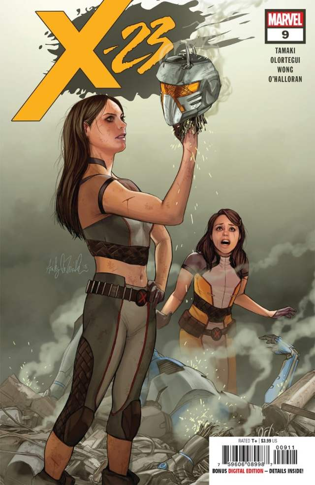 X-23 in the foreground holding up the head of a robot, Gabby in the background with a frightened expression