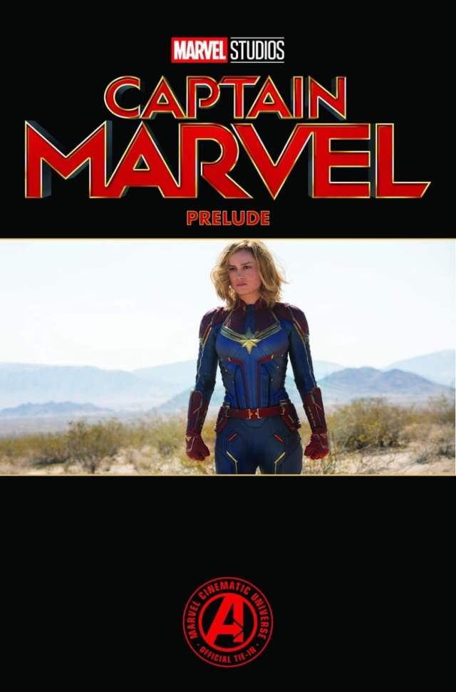 "Carol Danvers in her movie costume. The words ""Captain Marvel Prelude"" in red against a black backgoround"