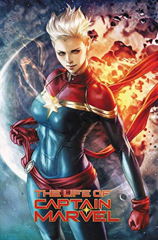 Captain Marvel with flame behind her. Text reads The Life Of Captain Marvel