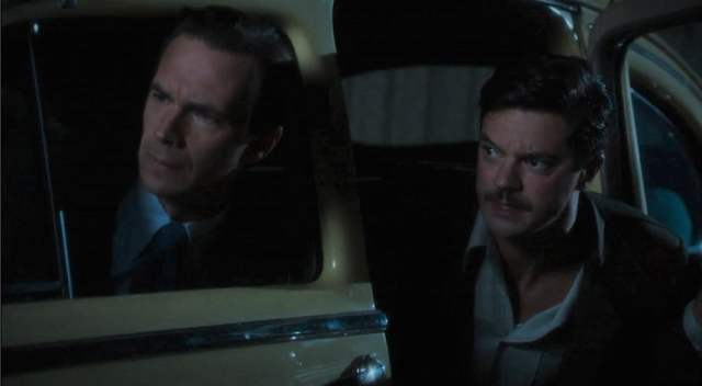 Edwin Jarvis and Howard Stark, circa 1946, leaning out of a car to look in shock at something