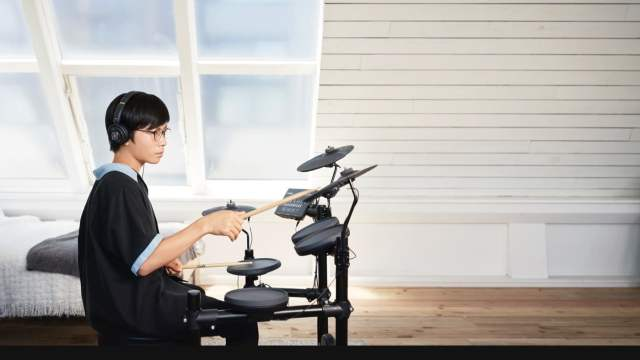 child playing electronic drums