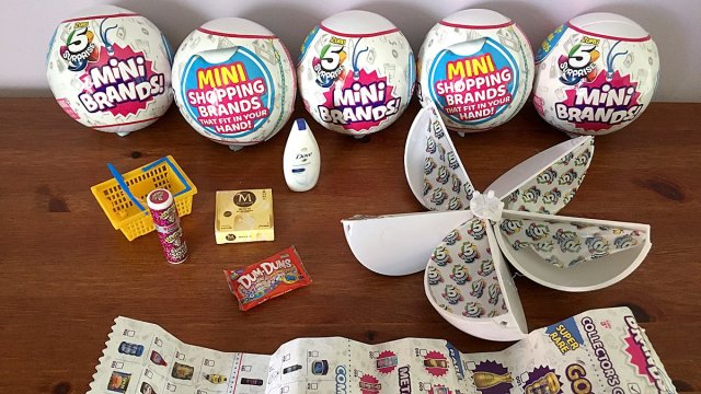 An Open Capsule Showing the Packaging and Content with Unopened Capsules Behind, Image: Sophie Brown