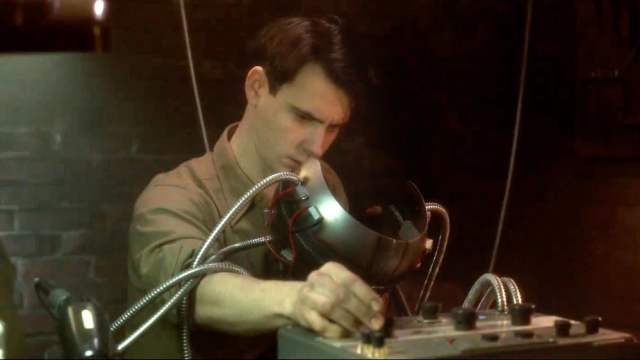 Harry Lloyd as Charles Xavier working on a Cerebro prototype