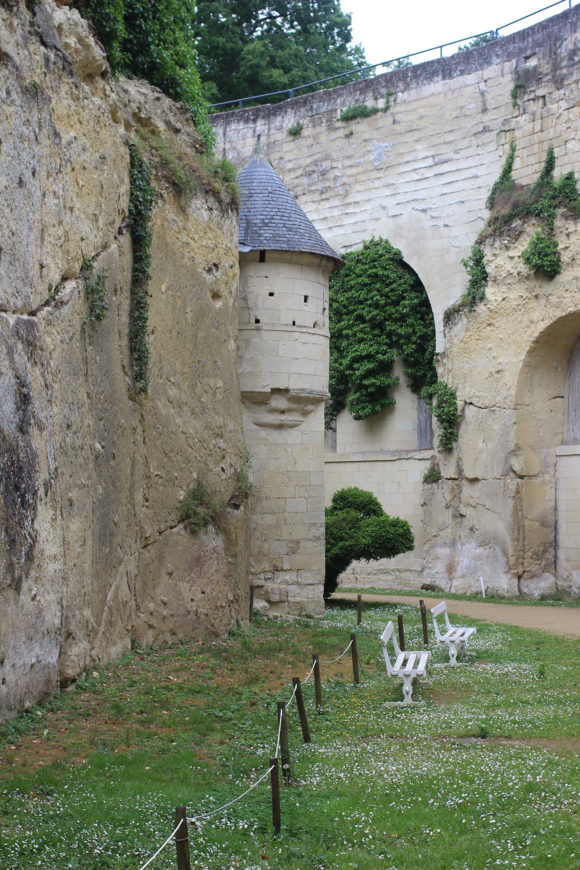 Inside the dry moat of Chateau de Breze, with the defensive tower.