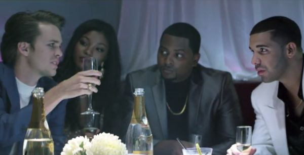 Screen capture: Drake and his friends celebrating before he receives the call