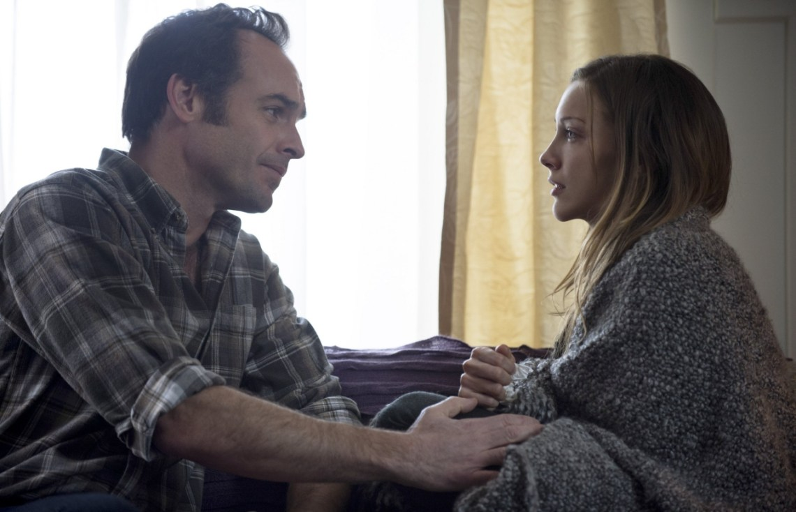 Paul Blackthorne and Katie Cassidy Courtesy of The CW