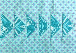 aqua flying geese quilt block