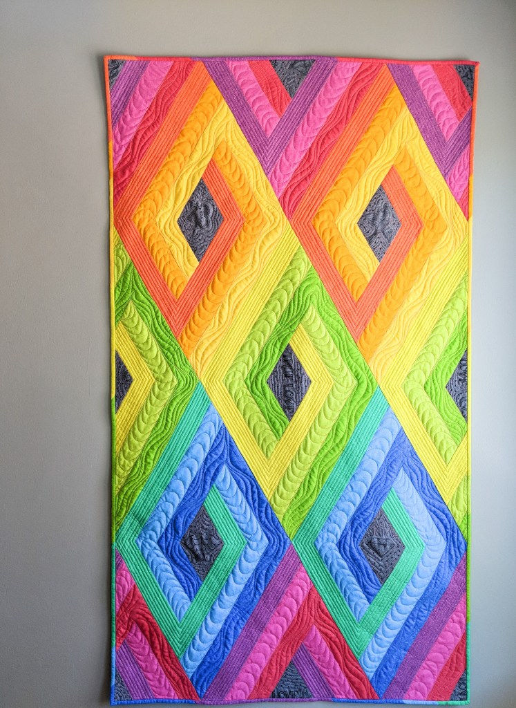 Vortex quilt by Geeky Bobbin in Phosphor fabric by Libs Elliott