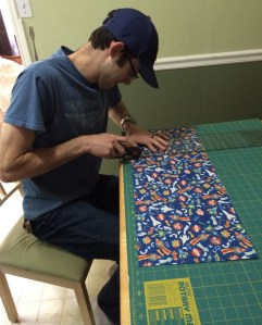 Jason cutting fabric