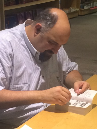 Correia signing a book