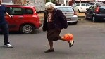 Ellerly Italian woman kicking soccer ball