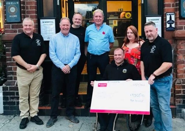 L to R - Jerry Carter (Carter's Advocates, sponsor), John Pearson (the brains behind the MGC), Chris Cooke, Trevor Latus (landlord of the Woody), Bruce Baker of the JDF, Sandy and Iain Wrigley.