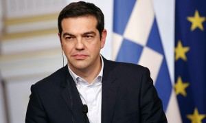 epa04603551 Greek Prime Minister Alexis Tsipras makes a statement with French President Francois Hollande (unseen) after their meeting at the Elysee Palace, in Paris, France, 04 February 2015. Greek Prime Minister Alexis Tsipras met with EU leaders during a week of intense diplomatic efforts by Athens' new government to renegotiate the terms of its international bailout.  EPA/YOAN VALAT