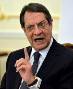 Cyprus' President Nicos Anastasiades gestures speaking at a joint news conference with Russian President Vladimir Putin in the Novo-Ogaryovo residence outside Moscow, Russia, Wednesday, Feb. 25, 2015. (AP Photo/Yuri Kadobnov, Pool)