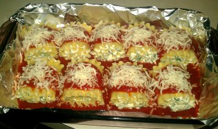 Lasagna noodles rolled up and ready to go into the oven...