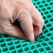 Fingers into gel wheelchair cushion