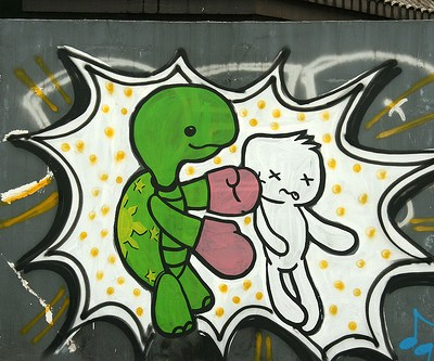 graffiti of a turtle punching someone