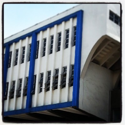 concrete building with blue frame