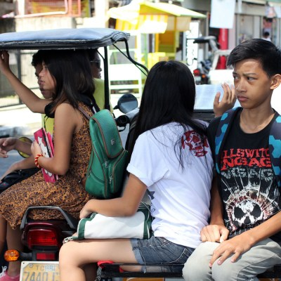 tricycle passengers