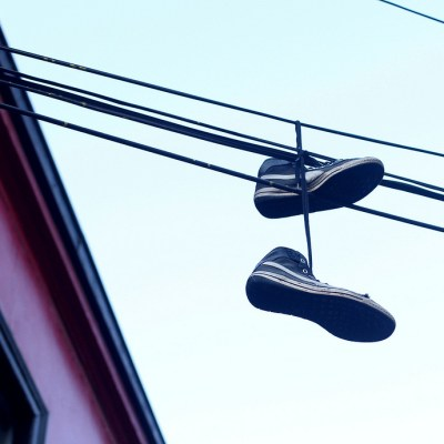 Converse shoes on wires