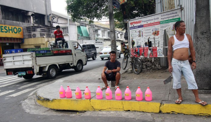 guy selling bottles of pink stuff