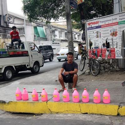guy selling bottles of pink stuff