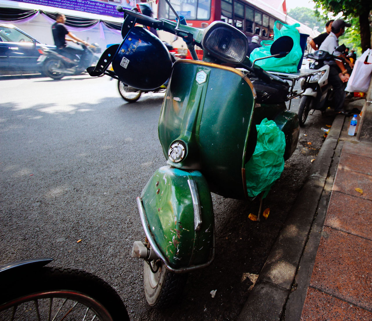old green Vespa motorcycle