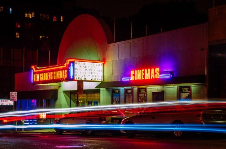 A cinema all lit up at night time, a front shot!