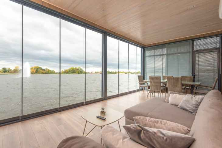 interior of contemporary house on lake on cloudy day
