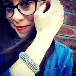 Bracelet: 1950s, Gemma Redmond Vintage Shirt: Zara Glasses: Versace