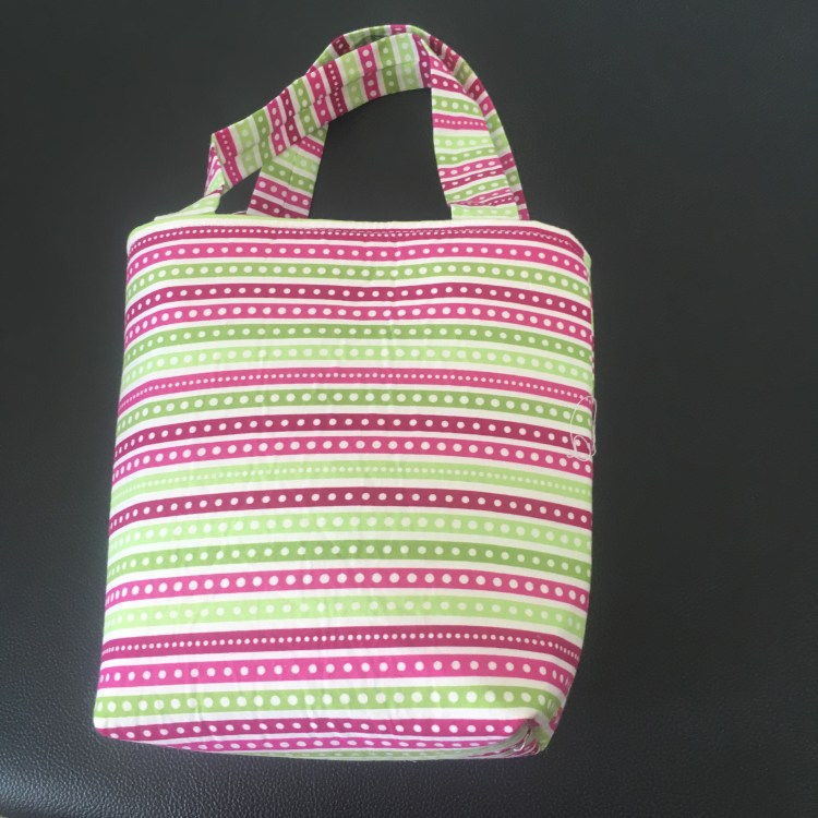Image of bright pink and green striped bag
