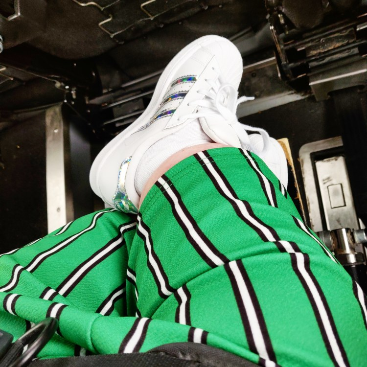 Gem styling green trousers with black and white stripes down
