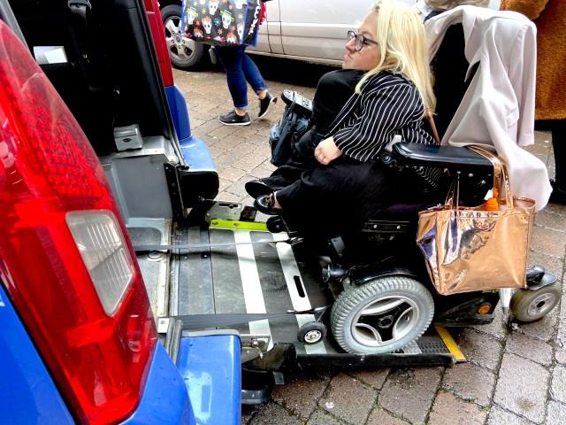 Gem in wheelchair entering Uber Access