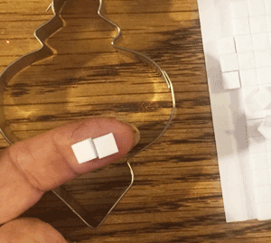 "Photo showing 2 - 1/4"" squares of foam adhisive squares."