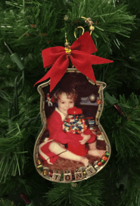 A photograph of a Cookie Cutter Ornament featuring a photo of David Anthony Whedbee