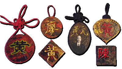 """Photos of 3"""" Ornaments with the Wong and Leo Family monogram on them."""