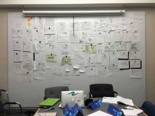 85 of the team's brainstormed ideas in a pin-up.