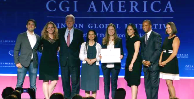GA co-founder and CEO Jake Schwartz receiving donation at CGI America.