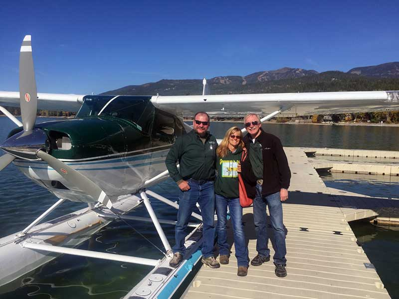 Wheel plane instructor Perry Brown (left), float plane instructor Terry Hayes and Peter Gross with their Cessna 180 on amphib floats at The Lodge at Whitefish Lake.