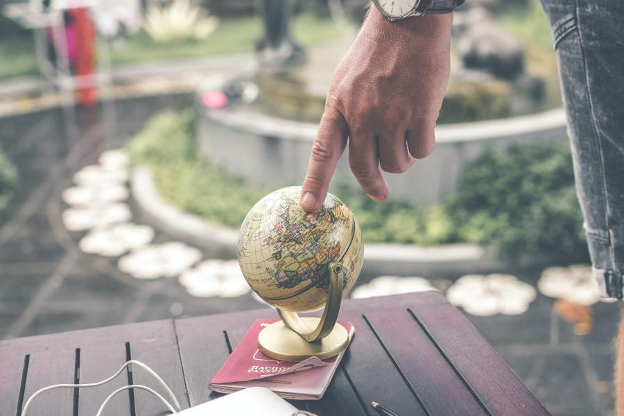 Image of a globe. Pexels image of man with small globe.