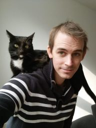 Picture of me (Lloyd), with my cat (Monochrome) in his favourite location... lying on someone's shoulders.