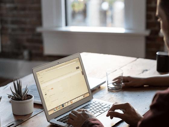 Man sitting at desk using a laptop