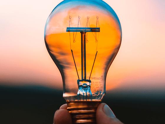 Lightbulb held by a hand