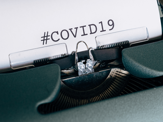 Typewriter typing out COVID-19
