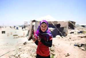 A girl living in a Syrian refugee camp.