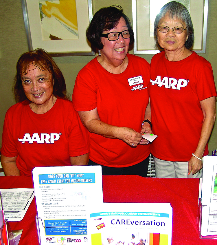The AARP table had more than a dozen volunteers throughout the day: (L–R) Pat Frank, Linda Inouye and Nancy Hironaka.