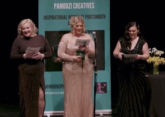 The vocal group receiving an Inspirational Women of Portsmouth Award