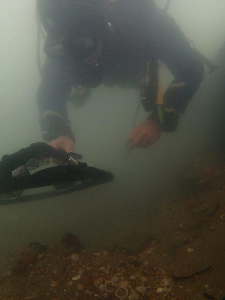 Dr Rodrigo Pacheco-Ruiz scanning the archaeological excavation site using a multi-source underwater photogrammetry rig (Image EEFE).OLYMPUS DIGITAL CAMERA