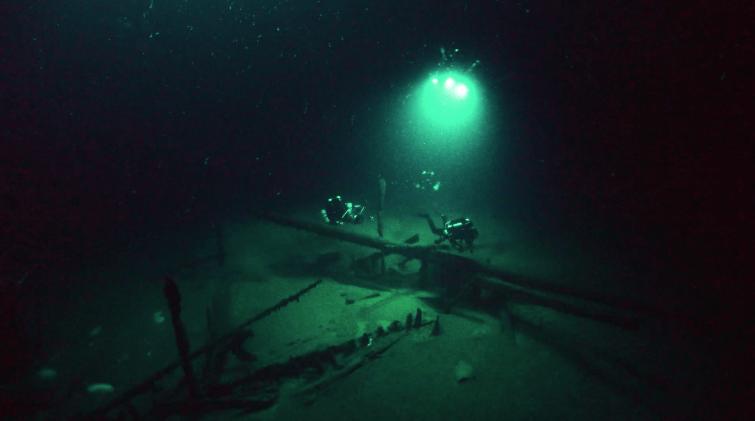 Professor Jon Adams inspects a 10th Century AD shipwreck, which lies 94m below the Black Sea surface. Photo Brian Gåre